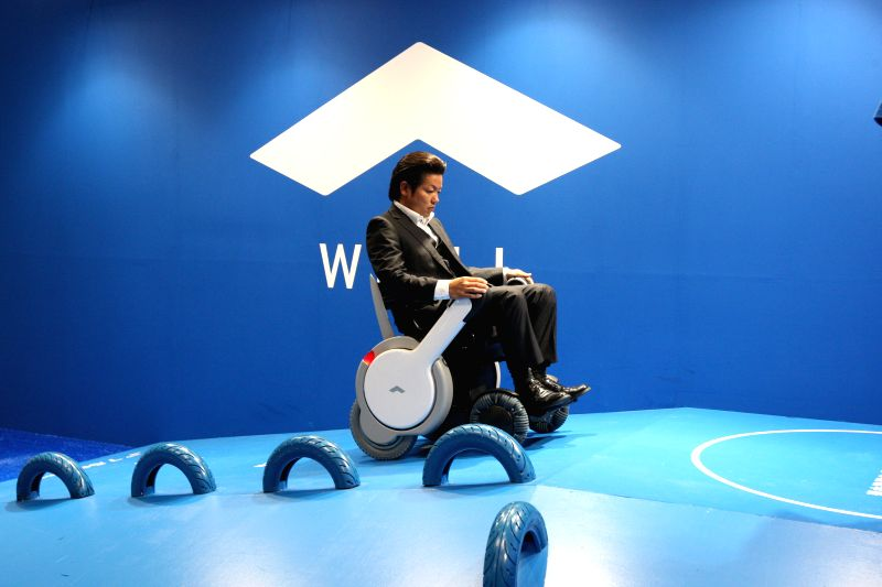 An electric wheel chair is displayed at the Tokyo Motor Show in Tokyo, Japan, Oct. 29, 2015. The 44th Tokyo Motor Show opened to the public on Thursday with the ...