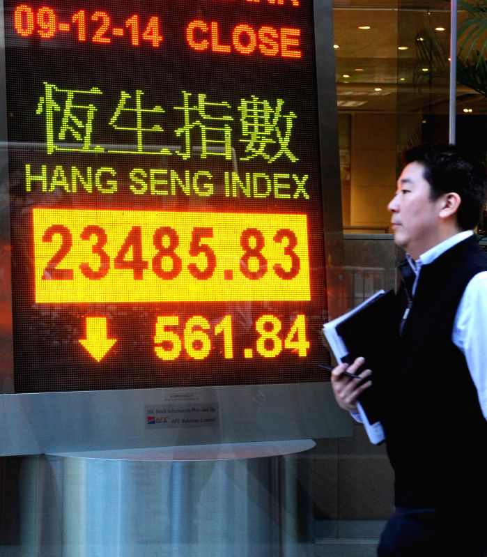 An electronic display showing Hong Kong's Hang Seng Index, which fell, to close at 23,485.83 points, compared with the previous trading day closed down 561.84 points, down by 2.34 per cent. Full-day .