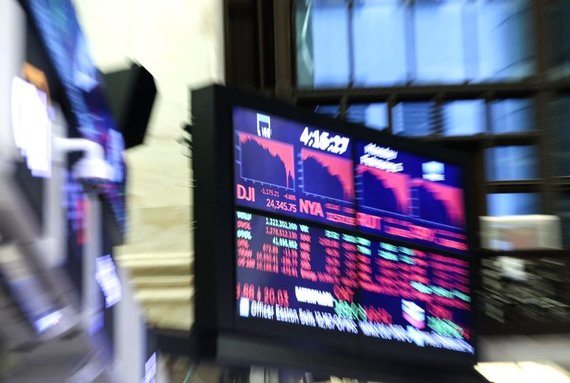 An electronic screen displaying trading data is seen at the New York Stock Exchange in New York. (Xinhua/Wang Ying/IANS)