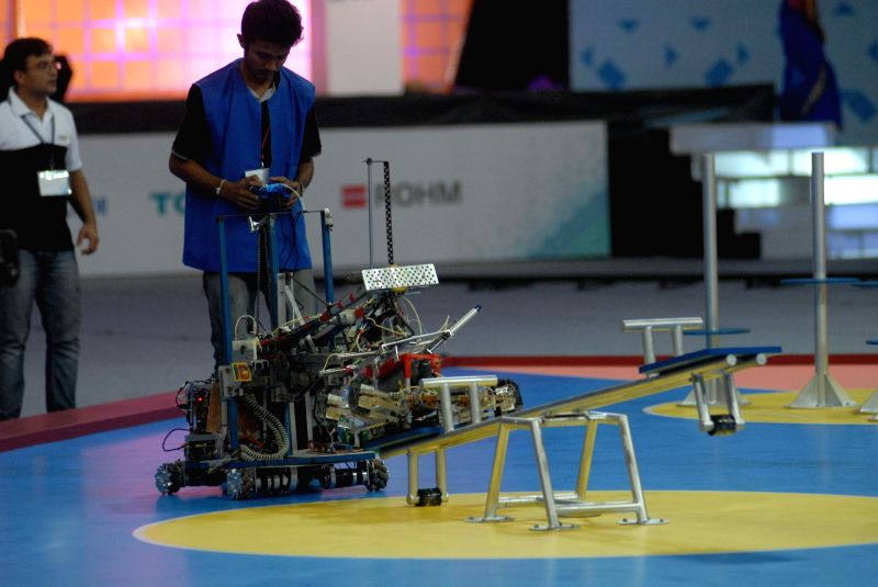 An engineering student from Sri Lanka presents his robot during 13th ABU International Contest at Balewadi Sports Complex in Pune on Aug 25, 2014. The theme for 13th ABU International Contest. The ...