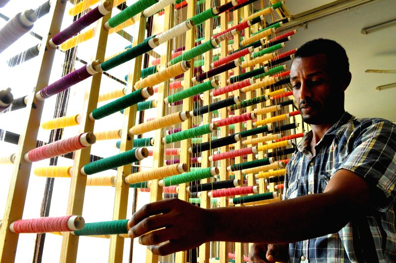 An Ethiopian bamboo artist during an international craft exposure programme on bamboo craft between India and Ethiopia being organised in Agartala on July 10, 2014.