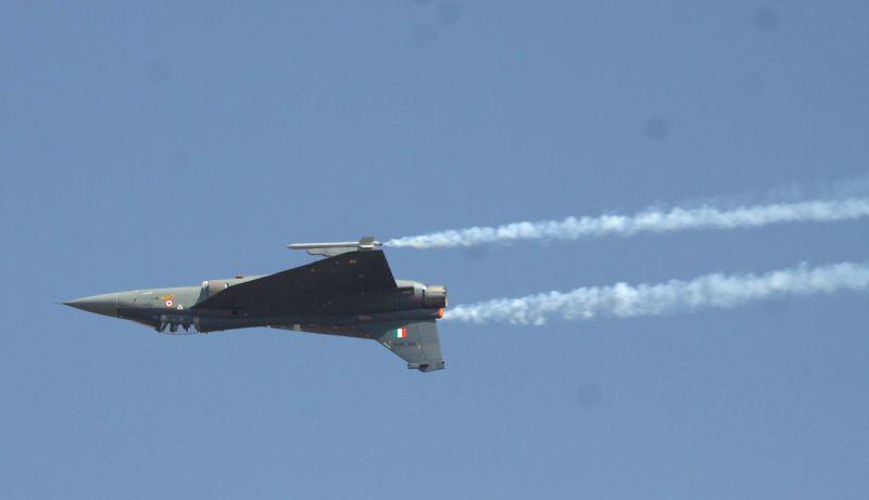 An IAF aircraft performs aerobatics during the Aero India-2015 Air Show, at Yelahanka Air-force Station, in Bengaluru on Feb 18, 2015.