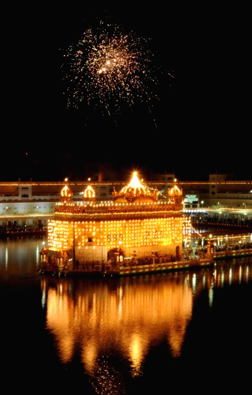 An illuminated Golden Temple on the occasion of birth anniversary of Guru Harkrishan Sahib in Amritsar on July 28, 2016.