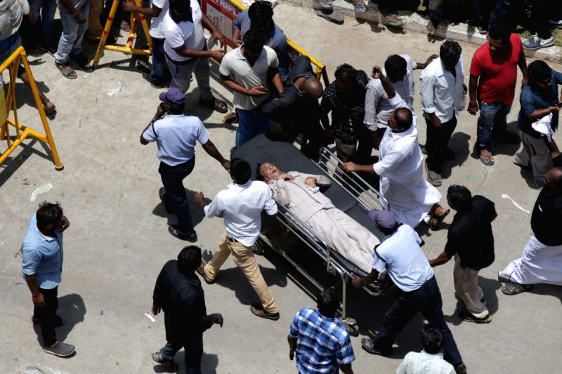 An injured being taken for treatment after a stampede broke out at Rajaji Hall, where the 94-year-old DMK patriarch and former Tamil Nadu Chief Minister M. Karunanidhi's body lays in state ... - M. Karunanidh