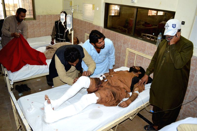 An injured man receives medical treatment at a hospital in southwest Pakistan's Quetta, Nov. 1, 2015. At least four people were killed and 10 others injured on Sunday ...