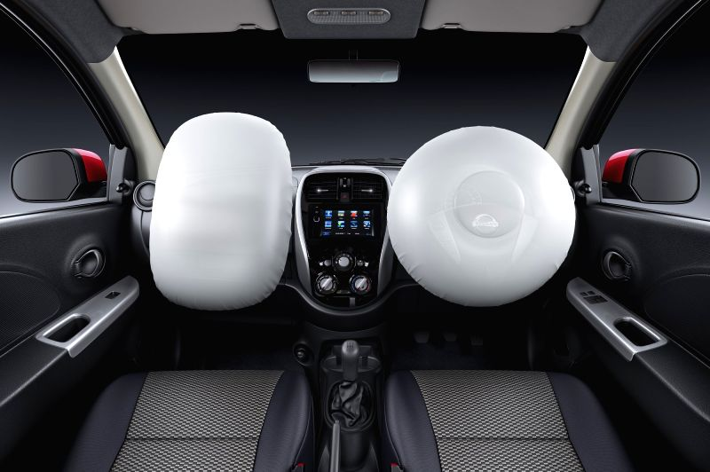 An inside view of the newly launched 2018 version of Nissan Micra. The newly introduced features include Dual Airbags, Speed warning device, Speed-sensing Door Lock and Driver Seat Belt Reminder ...