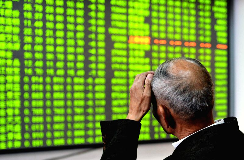 An investor reacts as Hong Kong's Hang Seng Index fell, to close at 23,485.83 points, compared with the previous trading day closed down 561.84 points, down by 2.34 per cent. Full-day total turnover .