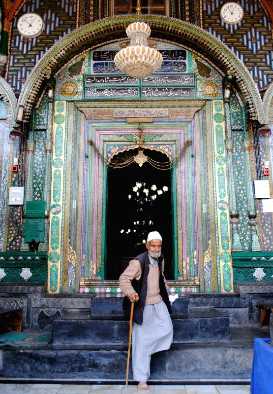 An old man at the Shah Hamdan Mosque located on the banks of Jhelum river in Khankahi Mowla of Srinagar on May 14, 2014.