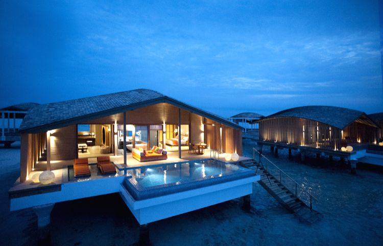 An overwater villa at Club Med Finolhu island resort in Maldives.