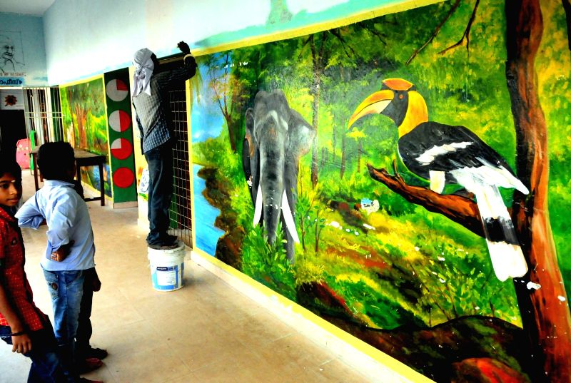 An upper primary school in Kannur being spruced up with art work ahead of reopening of the school on May 29, 2017.