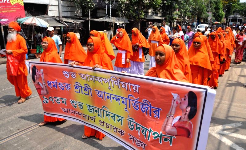 Anand Margis participate in a procession organised on birth anniversary of Anandamurti in Kolkata, on May 10, 2017.