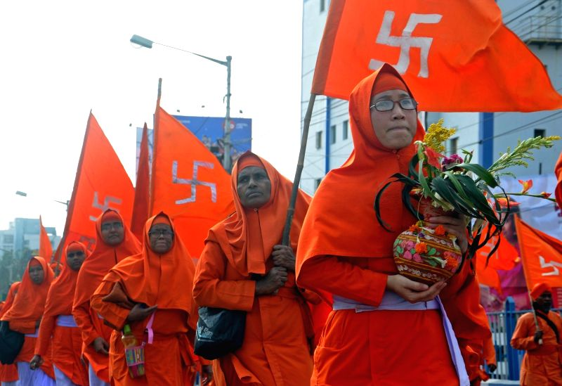 Ananda Marga Pracaraka Sangha participate in a rally organised to demand justice for he 16 monks and a nun of the order who were burnt alive on Kolkata's Bijon Setu in 1982; in Kolkata on ...