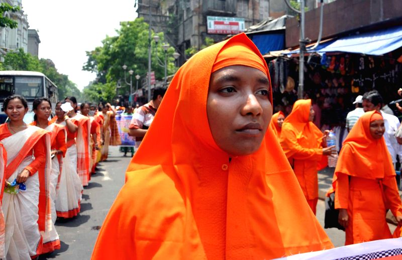 Ananda Margis participate in a procession organised on 93rd Birth anniversary of Anandamurti in Kolkata on May 14, 2014.