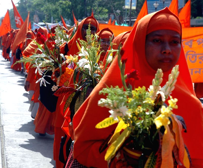 Ananda Margis participate in a procession taken out in memory of the killing of 17 Ananda Margi monks and nuns at Bijon Setu on 30th April, 1982, in Kolkata on April 30, 2014.