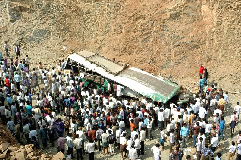 People in large numbers gather around the ill fated bus that met with an accident  in Andhra Pradesh's Anantapur district on Jan 7, 2015. At least 14 passengers, half of them students, ...