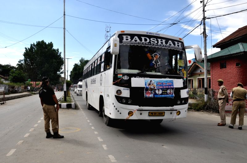 Anantnag: 20th batch comprising 4158 of Amarnath pilgrims reach Anantnag amid tight security to offer prayers at the holy cave shrine of Amarnath in South Kashmir on July 21, 2019. (Photo: IANS)