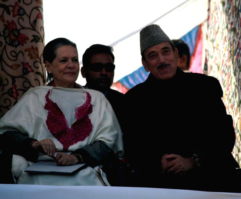 Congress chief Sonia Gandhi with party leader Ghulam Nabi Azad during a rally in Shangas of Anantnag district in Jammu and Kashmir on Dec 10, 2014.