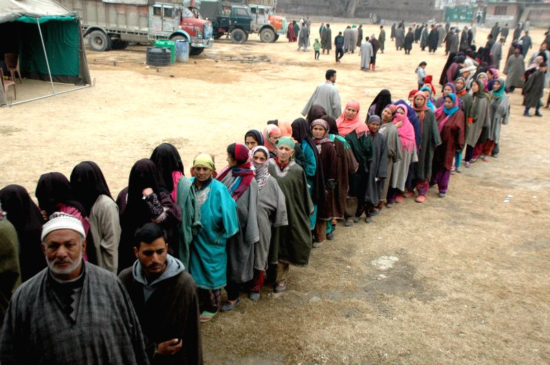 People queue-up to cast their votes during the fourth phase of Jammu and Kashmir assembly polls in Verinag of Jammu and Kashmir's Anantnag district on Dec 14, 2014.
