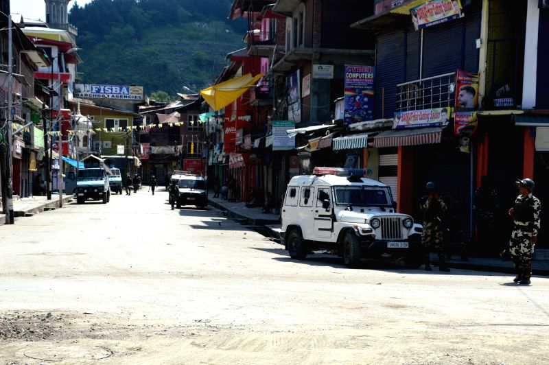 :Anantnag: Security beefed up after two militants were killed in a gunfight with the security forces in Jammu and Kashmir's Anantnag town on July 25, 2018. (Photo: IANS).