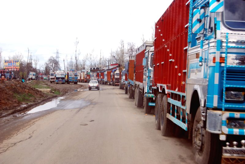 Trucks remain stranded on Jammu-Srinagar national highway which remained closed for the fourth consecutive day following landslides triggered by heavy rain in Anantnag on April 4, 2015.