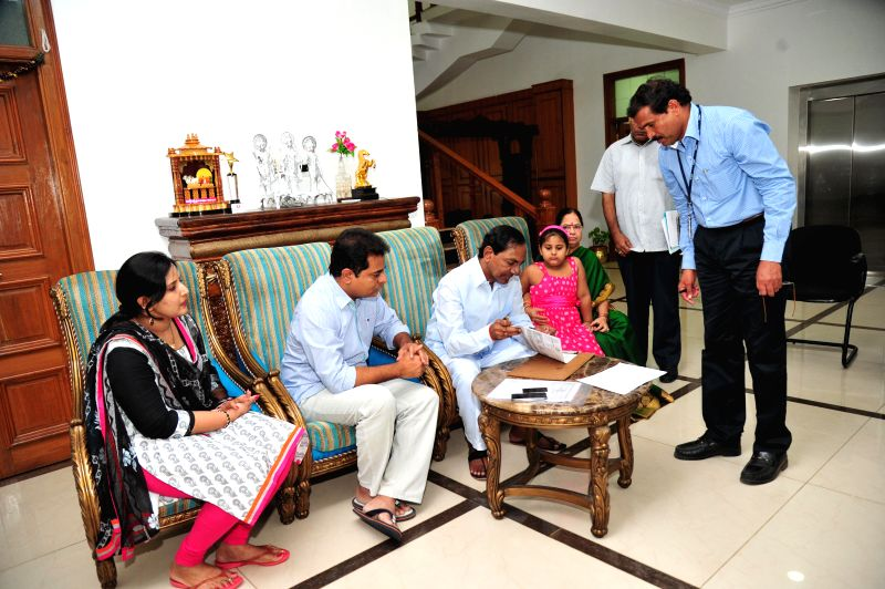 Andhra Governor ESL Narasimhan participates in Intensive Household Survey-2014, (Samagra Kutumba Survey) at Camp Office in Hyderabad on Aug 19, 2014.