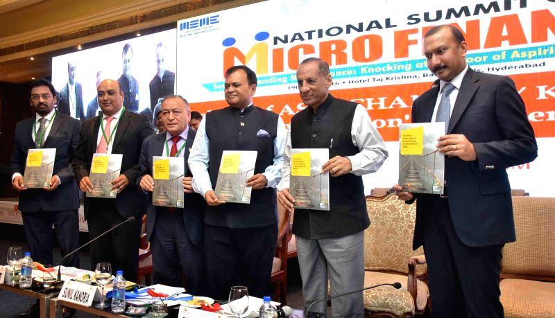 """Andhra Pradeh and Telangana Governor ESL Narasimhan during the inauguration of """"National Summit on Micro Finance"""" in Hyderabad on July 19, 2016. Also seen ASSOCHAM President ..."""