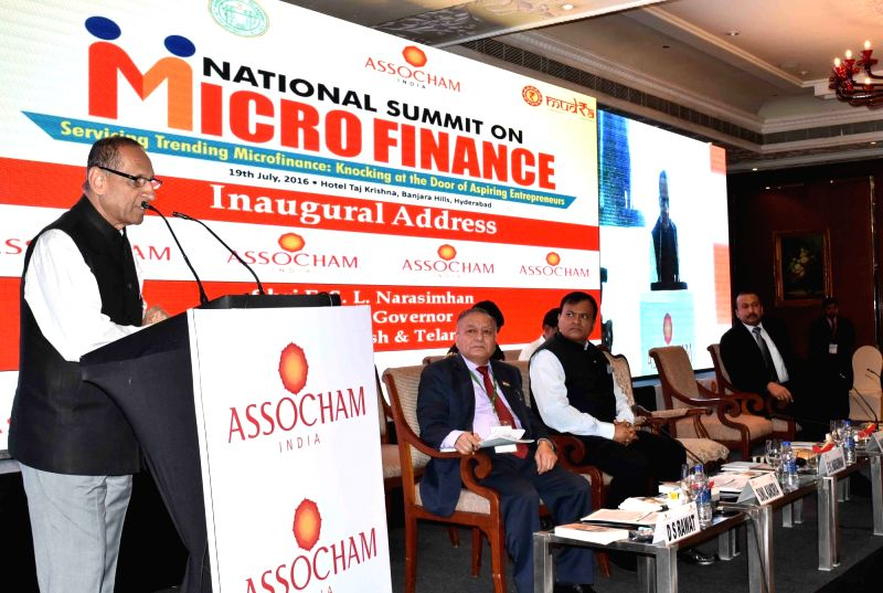 """Andhra Pradeh and Telangana Governor ESL Narasimhan addresses during the inauguration of """"National Summit on Micro Finance"""" in Hyderabad on July 19, 2016. Also seen ASSOCHAM ..."""