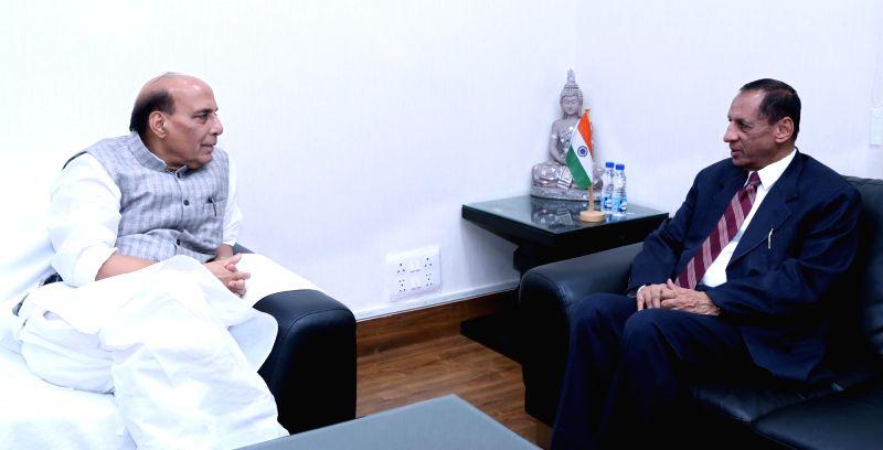 Andhra Pradesh and Telangana Governor E.S.L. Narasimhan meets Union Home Minister Rajnath Singh, in New Delhi on July 18, 2018. - Rajnath Singh