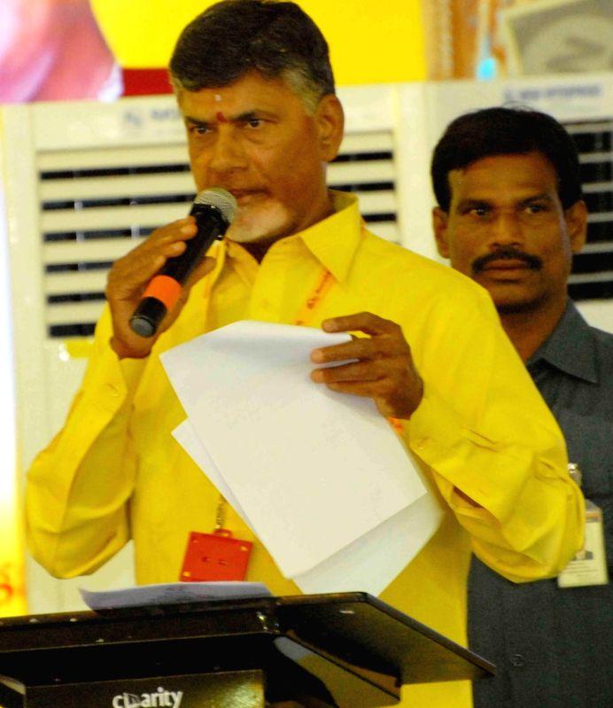 Andhra Pradesh Chief Minister and TDP chief N Chandrababu Naidu addresses during the inauguration of Telugu Desam Party's 'Mahanadu' -mega-convention- in Tirupathi on May 27, 2016. - N Chandrababu Naidu