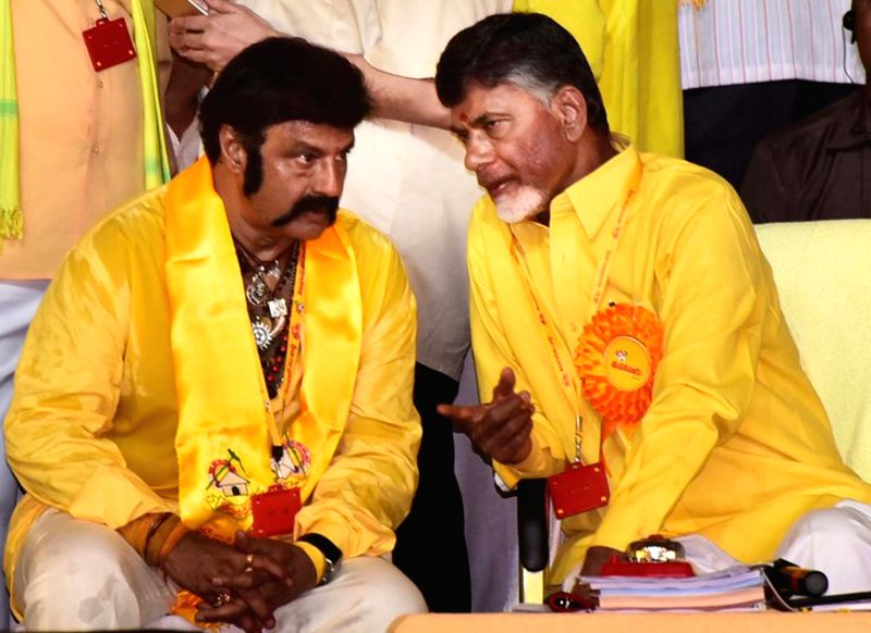 Andhra Pradesh Chief Minister and TDP chief N Chandrababu Naidu interacts with actor-turned politician Nandamuri Balakrishna during Telugu Desam Party's 'Mahanadu' -mega-convention- in ... - N Chandrababu Naidu