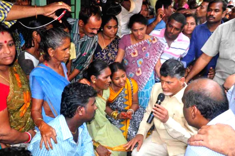 Andhra Pradesh Chief Minister N Chandera Babu Naidu consoling the families of Indian Air Force AN 32 plane which has gone missing, in Visakhapatnam on July 23, 2016. - N Chandera Babu Naidu
