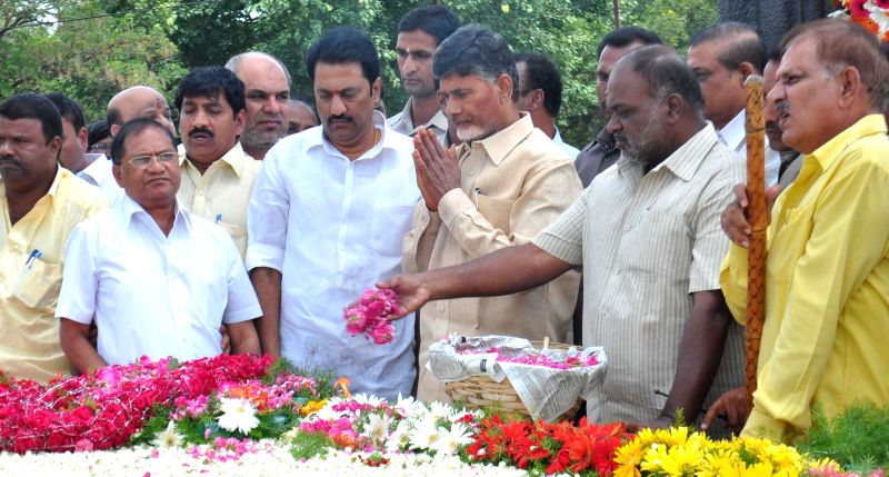 Andhra Pradesh Chief Minister N. Chandrababu Naidu pays tribute to NT Ramarao at NTR Ghat in Hyderabad on June 19, 2014. - N. Chandrababu Naidu