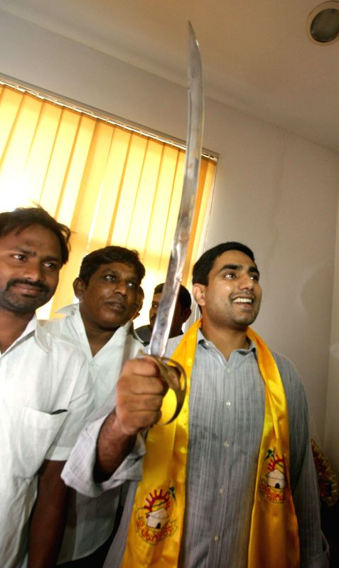 Andhra Pradesh Chief Minister N. Chandrababu Naidu's son, N. Nara Lokesh takes charge as TDP coordinator in Hyderabad on June 19, 2014. - N. Chandrababu Naidu