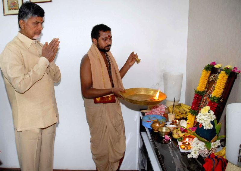 Andhra Pradesh Chief Minister N. Chandrababu Naidu offers prayers ahead of taking charge as the Chief Minister in Hyderabad on June 19, 2014. - N. Chandrababu Naidu