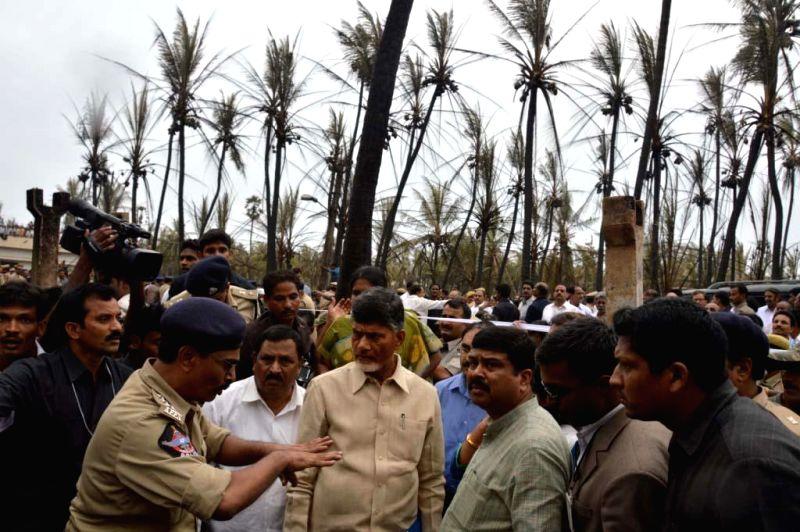 Andhra Pradesh Chief Minister N. Chandrababu Naidu visits the site where a blast and fire in a gas pipeline killed 14 people Friday morning Andhra Pradesh's East Godavari district on June 27, 2014. - N. Chandrababu Naidu