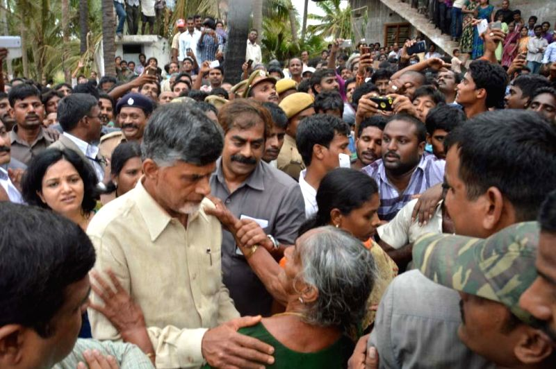 Andhra Pradesh Chief Minister N. Chandrababu Naidu interacts with people affected by a blast in a gas pipeline belonging to GAIL in Andhra Pradesh's East Godavari district on June 27, 2014. - N. Chandrababu Naidu