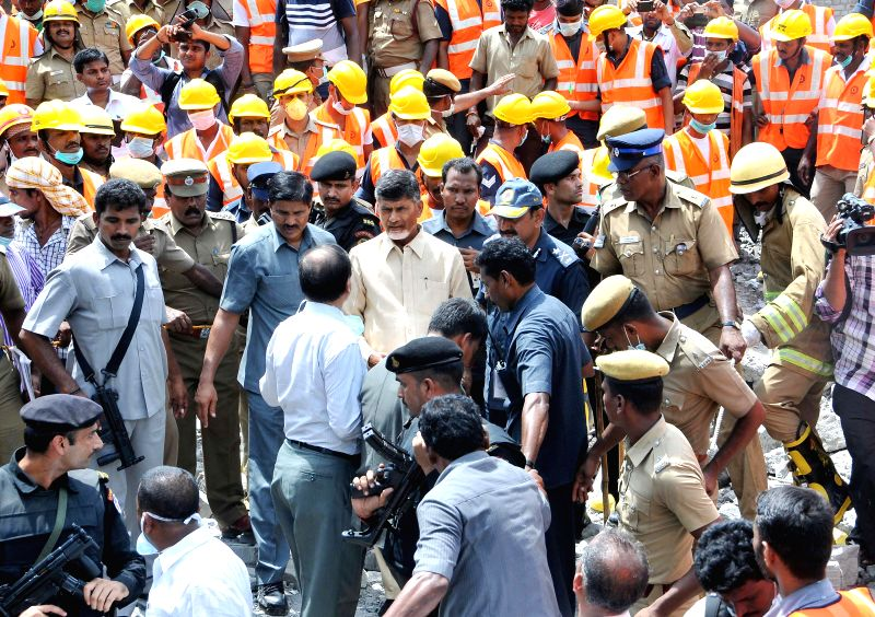 Andhra Pradesh Chief Minister N. Chandrababu Naidu visits the site where a portion of an eleven-storey building collapsed near suburban Porur, in Chennai on June 30, 2014.