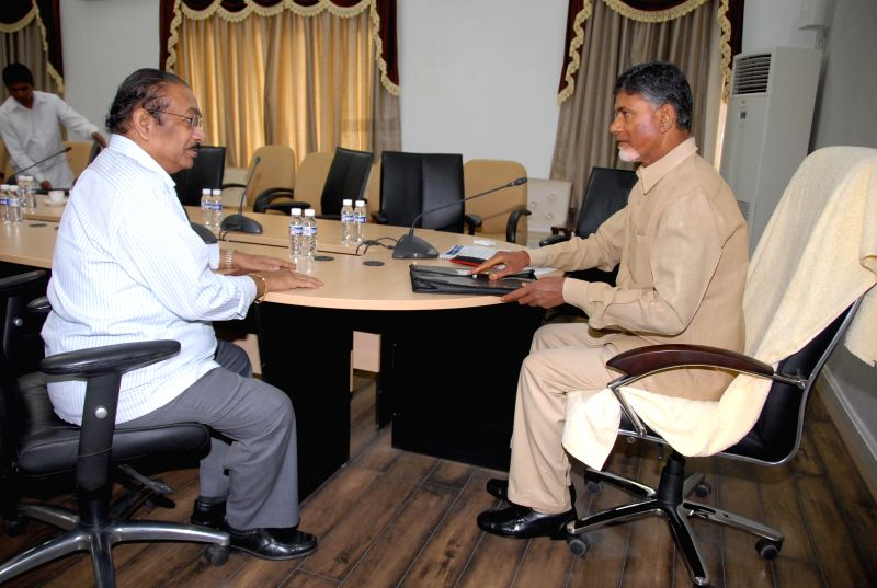 Andhra Pradesh Chief Minister N. Chandrababu Naidu andAndhra Pradesh Election Commissioner P. Ramakanth Reddy during a meeting in Hyderabad on July 9, 2014. - N. Chandrababu Naidu