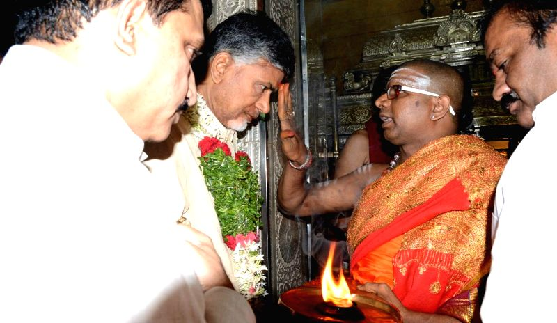 Andhra Pradesh Chief Minister N. Chandrababu Naidu offers prayers at Mahakali Temple in Secunderabad on July 13, 2014.