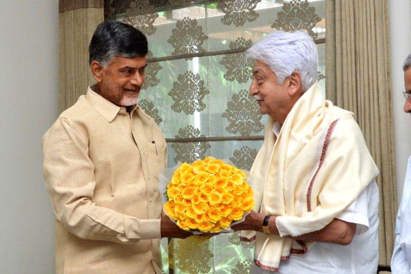 Andhra Pradesh Chief Minister N. Chandrababu Naidu and Wipro Chairman Azim Premji during a meeting in Hyderabad on July 27, 2014. - N. Chandrababu Naidu