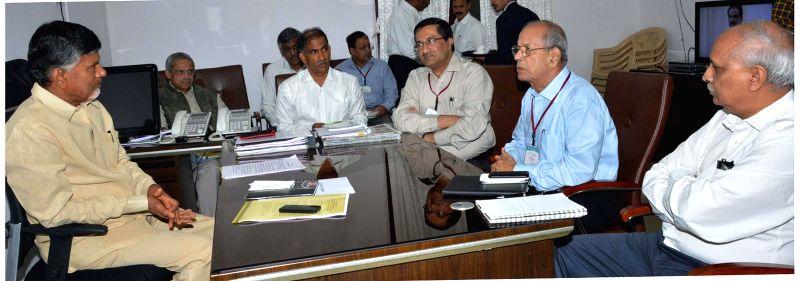 Andhra Pradesh Chief Minister N. Chandrababu Naidu during a meeting with Principal Advisor to Delhi Metro Rail Corporation (DMRC) E Sreedharan in Hyderabad on Sept 1, 2014. - N. Chandrababu Naidu