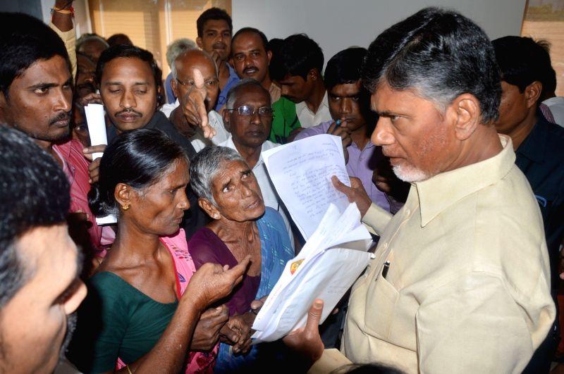 Andhra Pradesh Chief Minister N. Chandrababu Naidu hears public grievances in Hyderabad, on Nov 14, 2015. - N. Chandrababu Naidu
