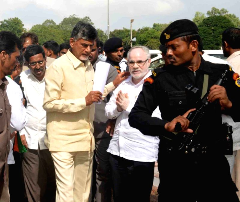 Andhra Pradesh Chief Minister N Chandrababu Naidu inspect the relief operations undertaken by the officials at different flood-hit areas of Nellore district, Andhra Pradesh on Nov 21, 2015. - N Chandrababu Naidu