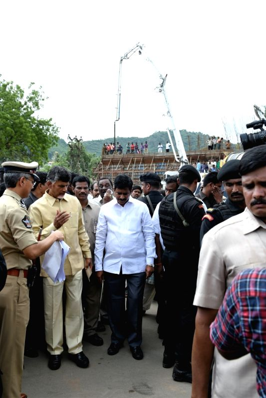 Andhra Pradesh Chief Minister N Chandrababu Naidu inspects the ongoing works at the Pushkar ghat in Vijayawada, Andhra Pradesh on July 21, 2016. - N Chandrababu Naidu