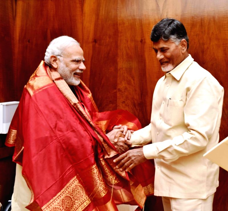 Andhra Pradesh Chief Minister N. Chandrababu Naidu calls on Prime Minister Narendra Modi in New Delhi, on Aug 5, 2016. - N. Chandrababu Naidu and Narendra Modi