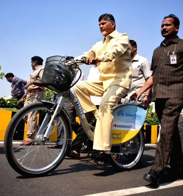 Andhra Pradesh Chief Minister N. Chandrababu Naidu launched the smart cycles by peddling from block II to block I of the Secretariat in Amaravati, Andhra Pradesh on Jan 31, 2018. - N. Chandrababu Naidu