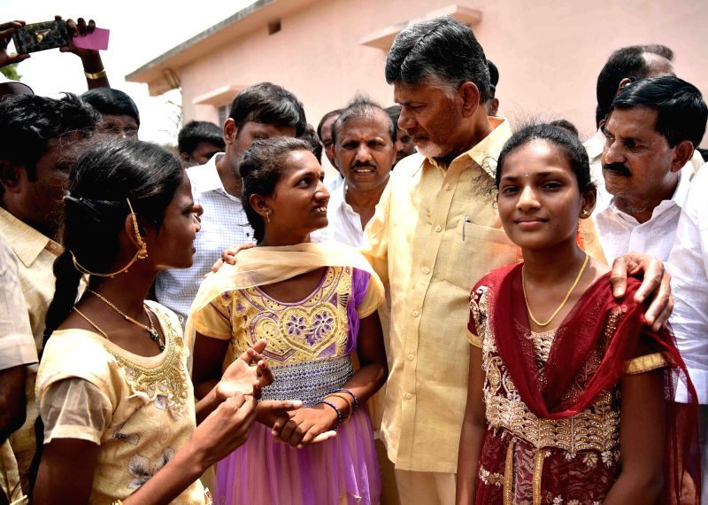 Andhra Pradesh Chief Minister N. Chandrababu Naidu interacts with people in Kadapa district of the state on June 7, 2018. - N. Chandrababu Naidu