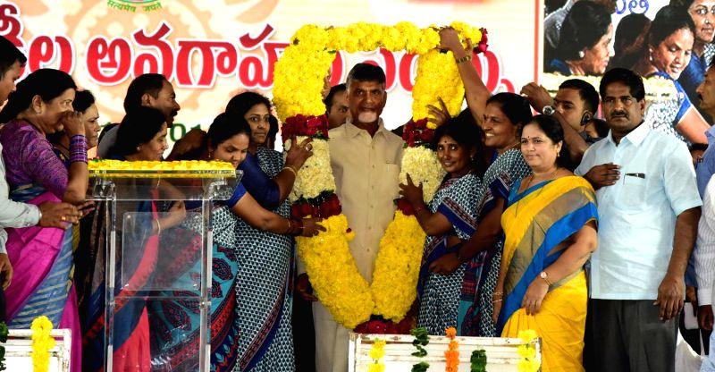 Andhra Pradesh Chief Minister N. Chandrababu Naidu being felicitated during an interactive session with Anganwadi workers, in Vijayawada on July 12, 2018. - N. Chandrababu Naidu