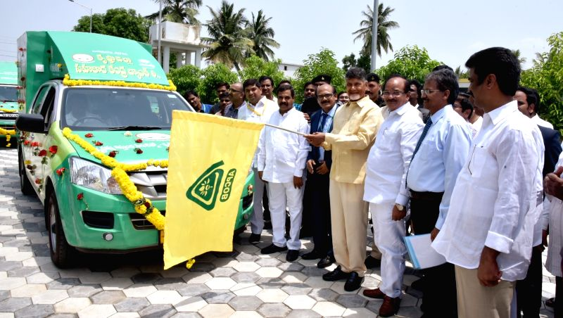 Andhra Pradesh Chief Minister N Chandrababu Naidu flag-offs  Andhra Pradesh State Co-Operative Bank Ltd (APCOB) mobile ATMs at Praja Vedika, in Vijayawada, on July 30, 2018. - N Chandrababu Naidu