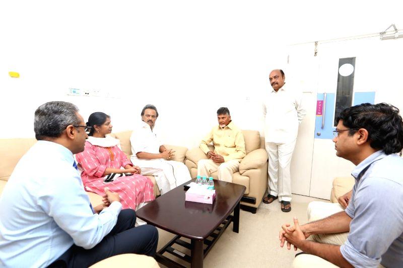 Andhra Pradesh Chief Minister N. Chandrababu Naidu with DMK leaders M.K. Stalin and Kanimozhi during his visit to the Kauvery Hospital where DMK President M. Karunanidhi is admitted, in ... - N. Chandrababu Naidu